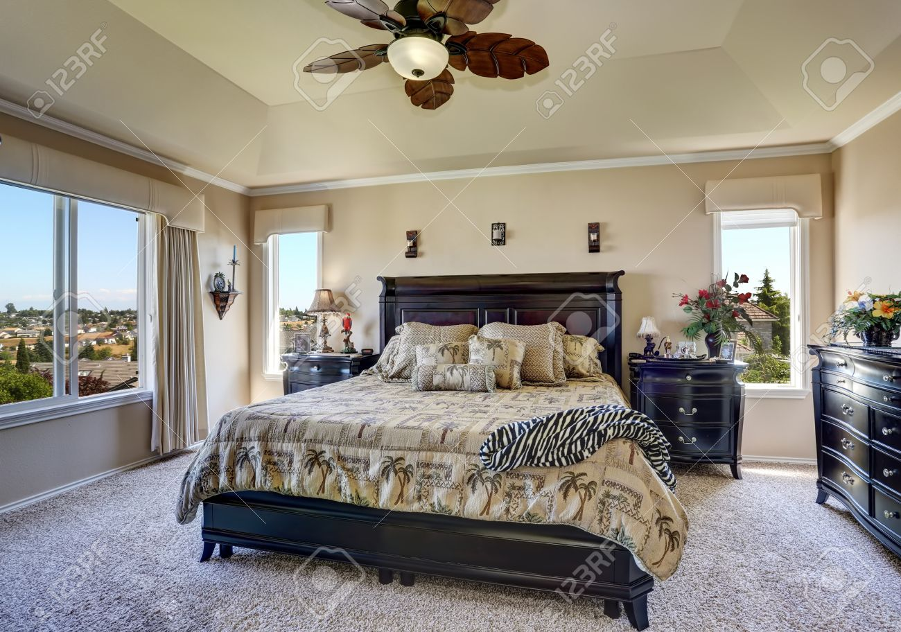 Luxury interior of master bedroom with black furniture. King..