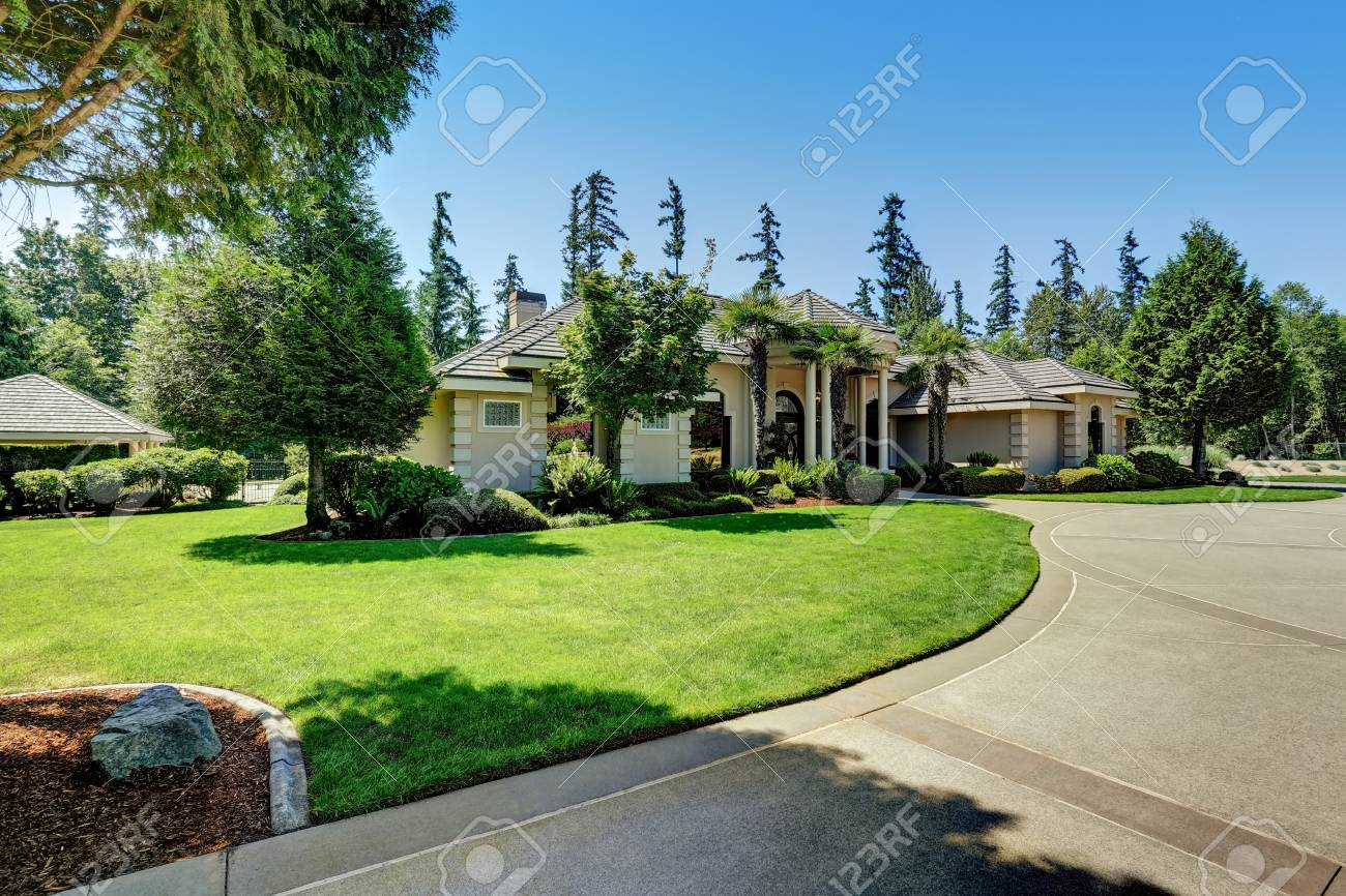 Stock Photo   Suburban Luxury Residential House With Perfect Landscape  Design And Blue Sky Background. Northwest, USA