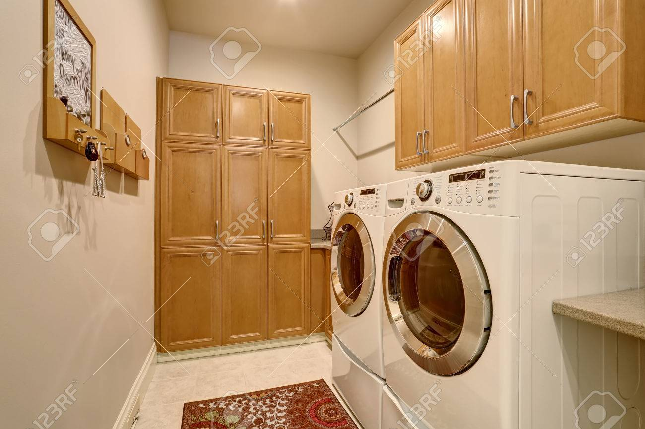 Interior Design Of Laundry Room With Modern Appliances And Cabinets.  Northwest, USA Stock Photo