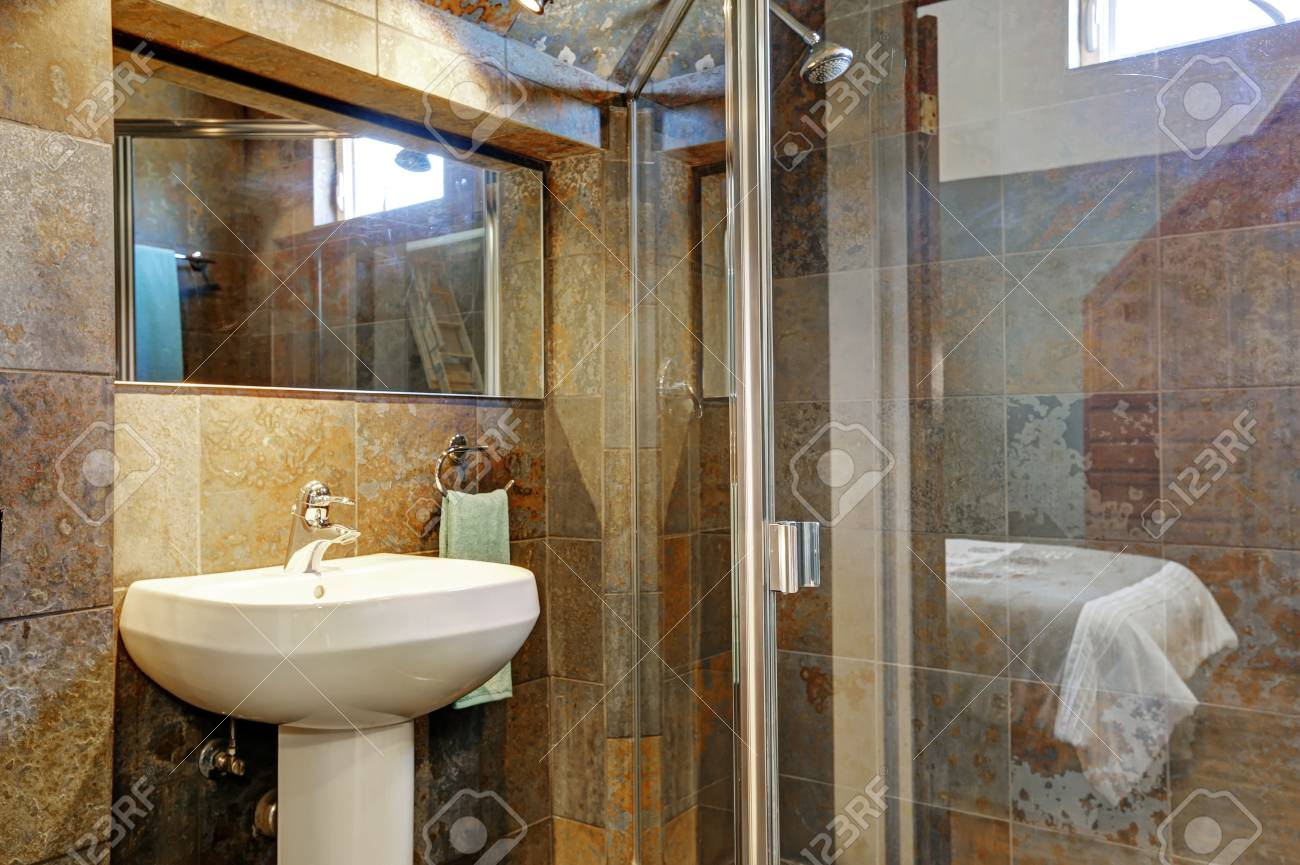 Luxury Bathroom Interior With Stone Walls View Of Glass Shower