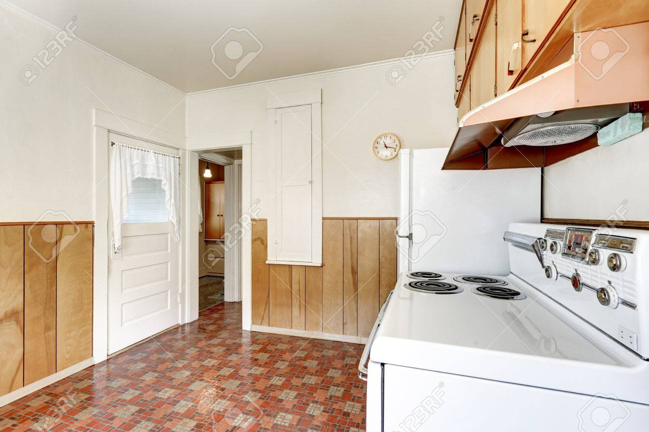 interior of old style kitchen with linoleum floor and wooden
