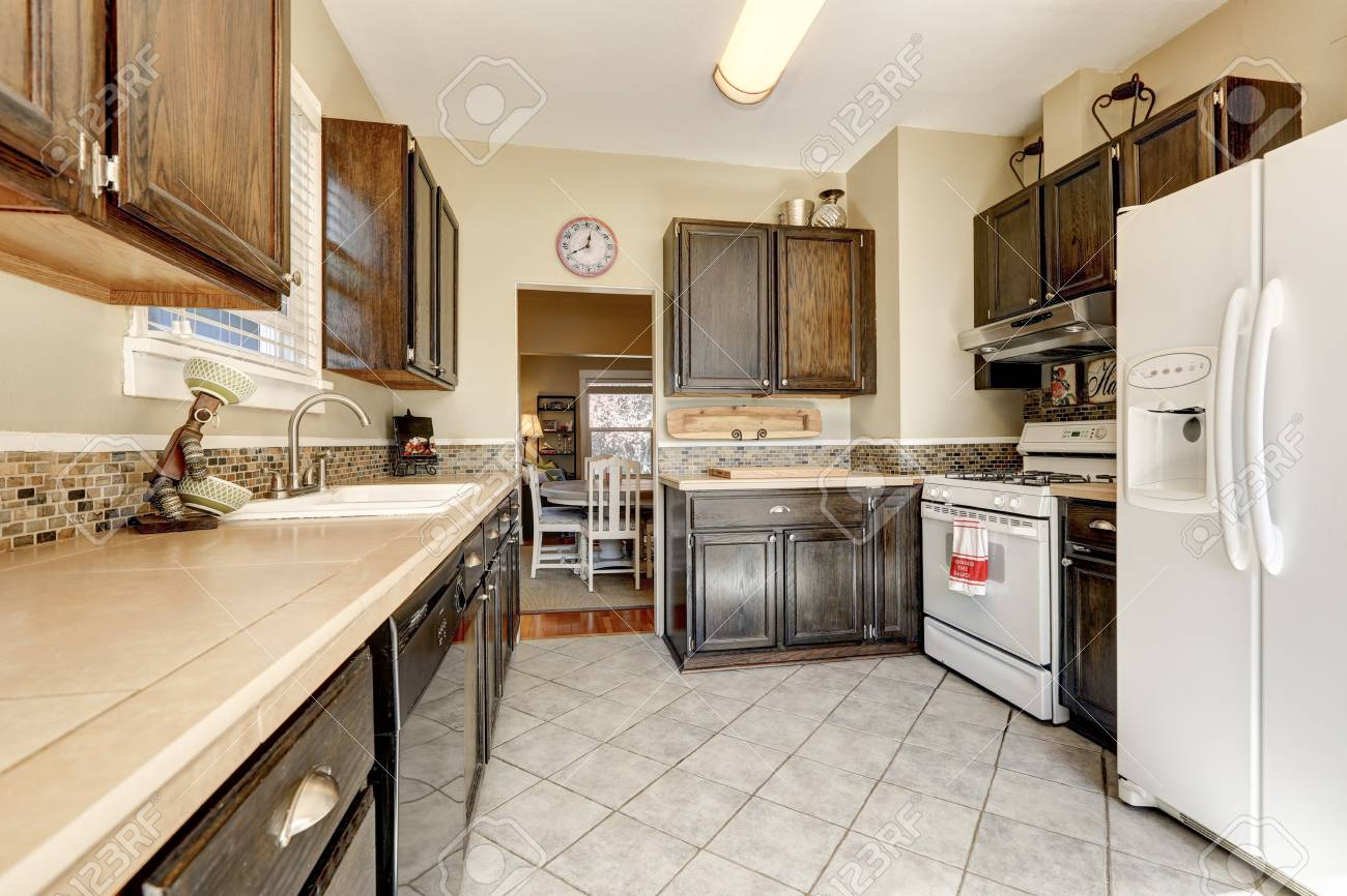 white kitchen cabinets with tile floor Kitchen Room Dark Brown Cabinets Tile Floor And White Appliances