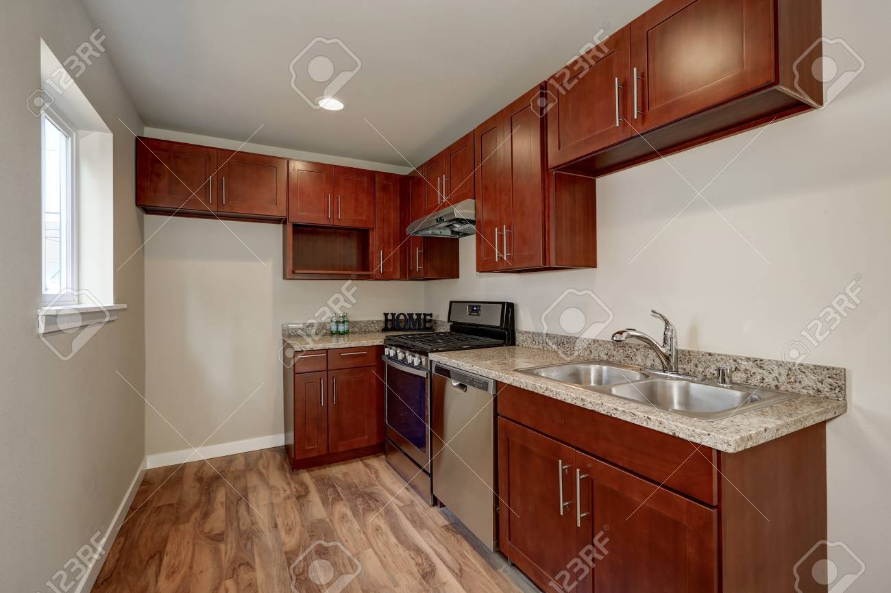View Of Burgundy Kitchen Cabinets With Granite Counter Top And