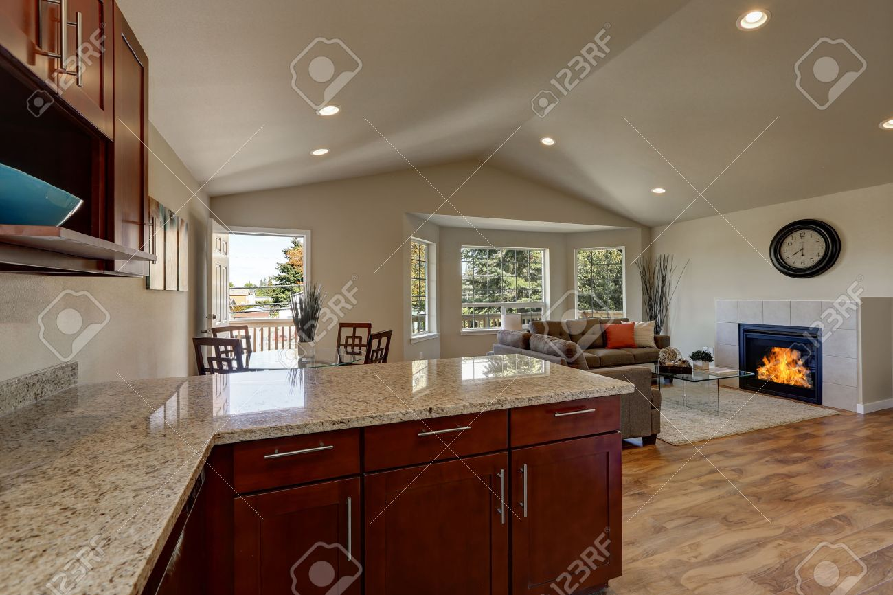 Open Floor Plan Of Kitchen, Dining And Living Rooms With Hardwood ...