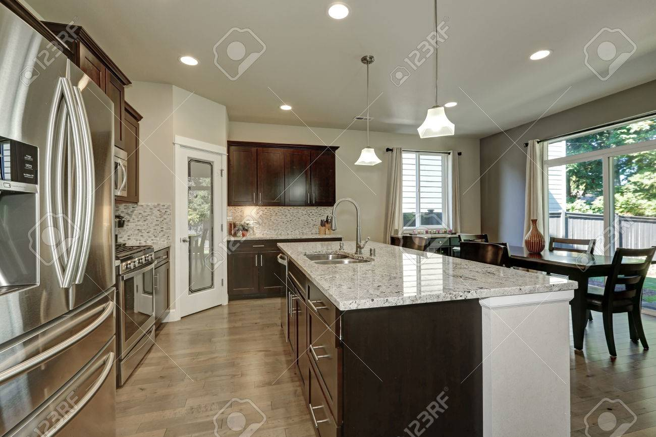Large kitchen island with granite counter top and drawers in..