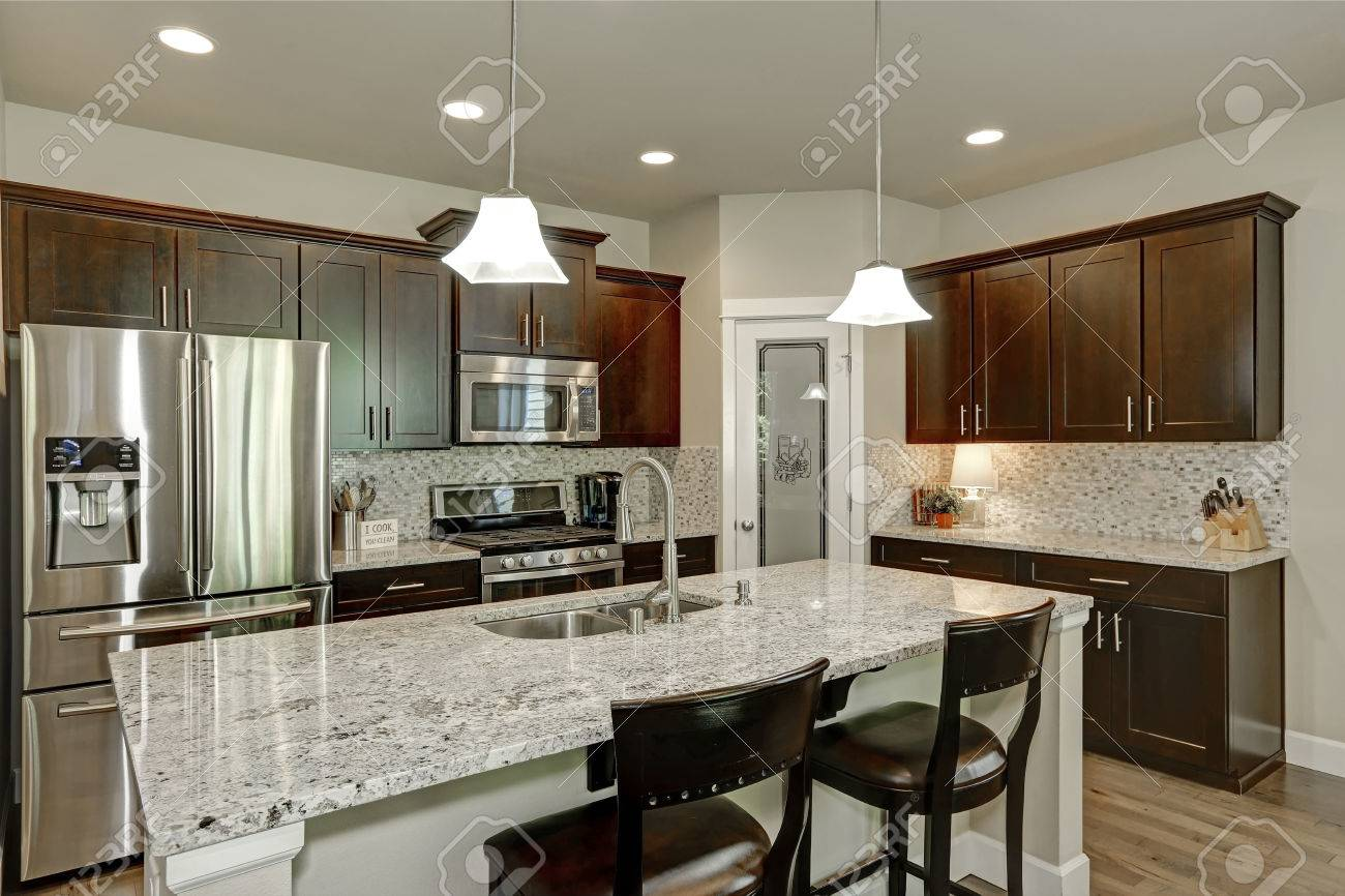Classic kitchen room interior with large kitchen island with..
