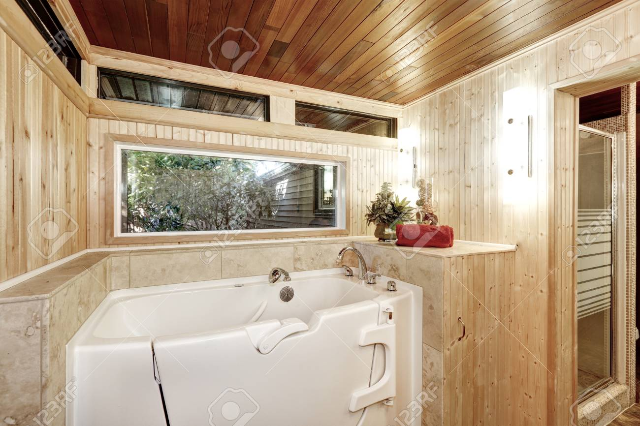 White Bath Tub In Wood Paneled Bathroom, Northwest, USA Stock Photo ...