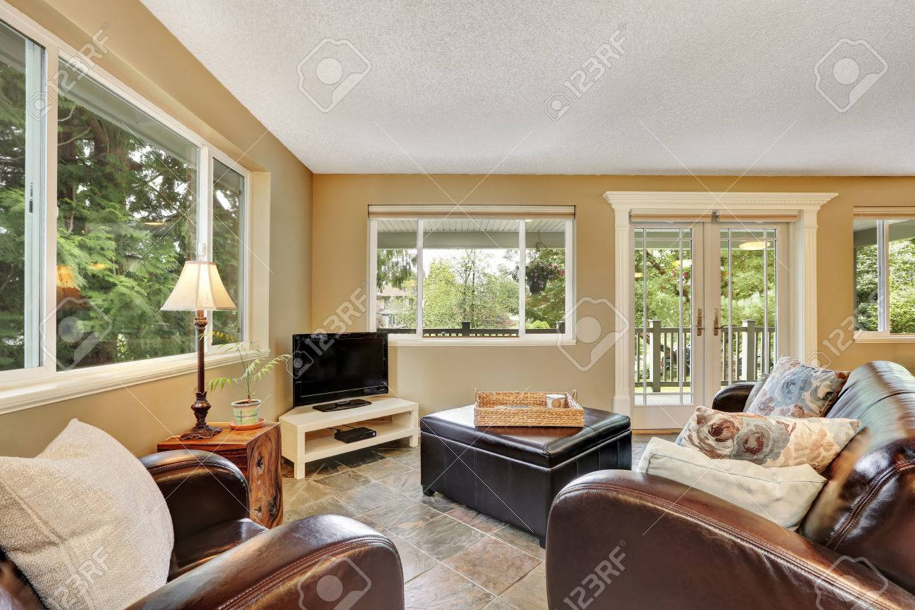 Living Room Interior With Large Leather Ottoman And Natural Stone Stock Photo Picture And Royalty Free Image Image 64698848