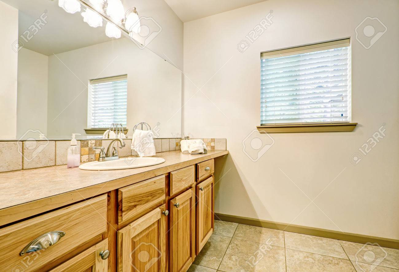 Bathroom Vanity Made Of Natural Wood And Large Mirror Northwest Stock Photo Picture And Royalty Free Image Image 64690860