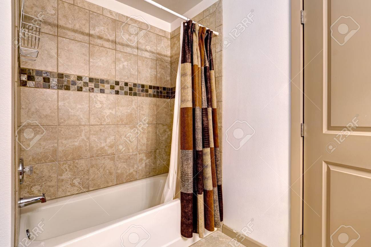 Clean Beige And White Bathroom With Mosaic Tile Wall Trim In.. Stock ...