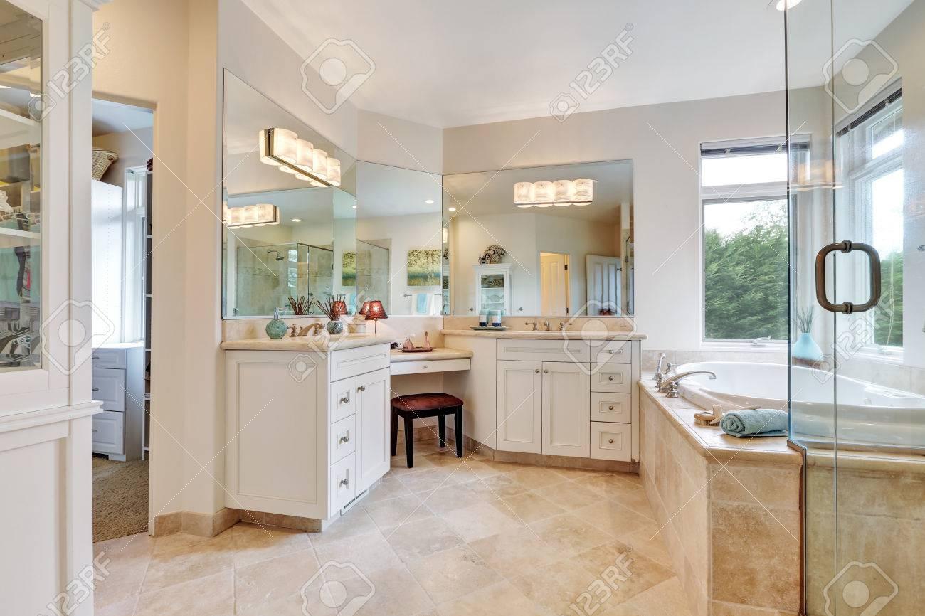 Master Bathroom Interior With Beige Tile Floor , Double Sink , Bath Tub.  Northwest,