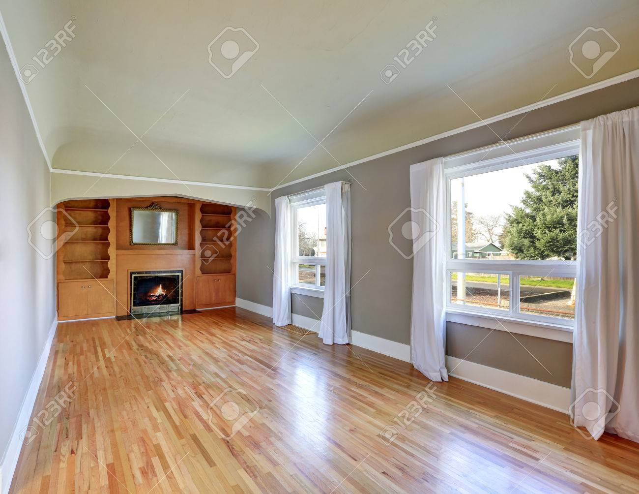 unfurnished living room interior in old craftsman house. gray