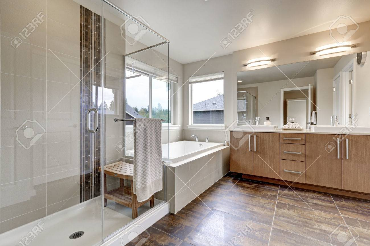 large double sink vanity. Stock Photo  White Modern Bathroom Interior In Brand New House Double Sink Vanity With Large Mirror Walk Shower White Bath Tub And Brown Tile Floor Modern Bathroom Interior In Brand House Sink