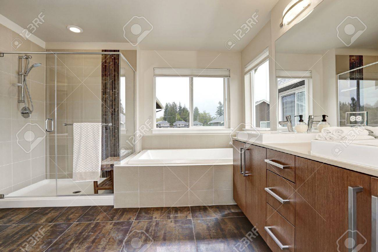 Brown And White Bathroom. White modern bathroom interior in brand new house  Double sink vanity with large mirror Modern Bathroom Interior In Brand House Sink