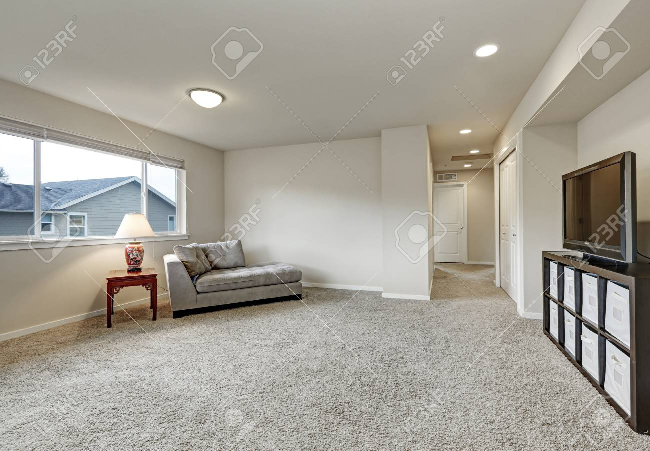 Empty Living Room Interior Upstairs With Grey Sofa Television And Carpet Floor Northwest