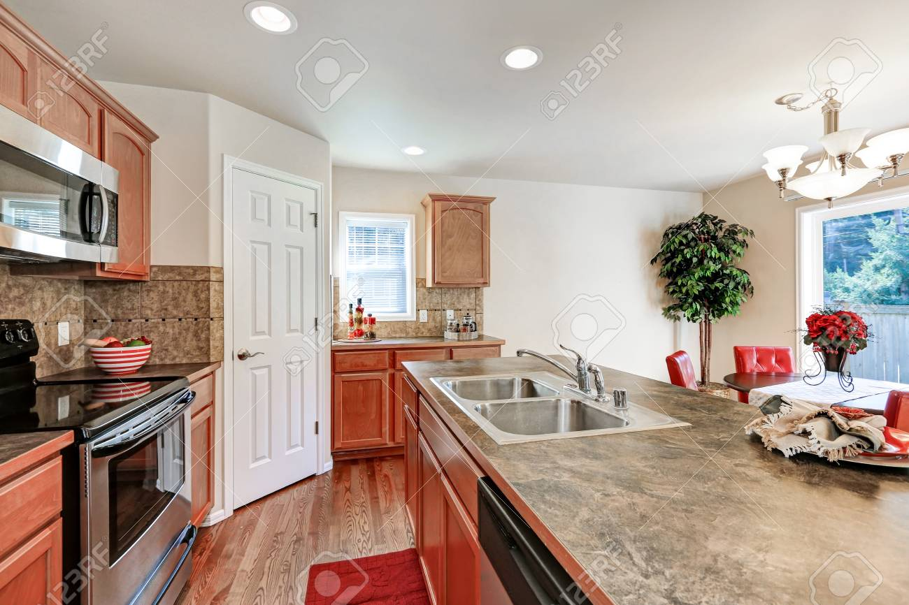 American Kitchen room in brown and white colors with backsplash..