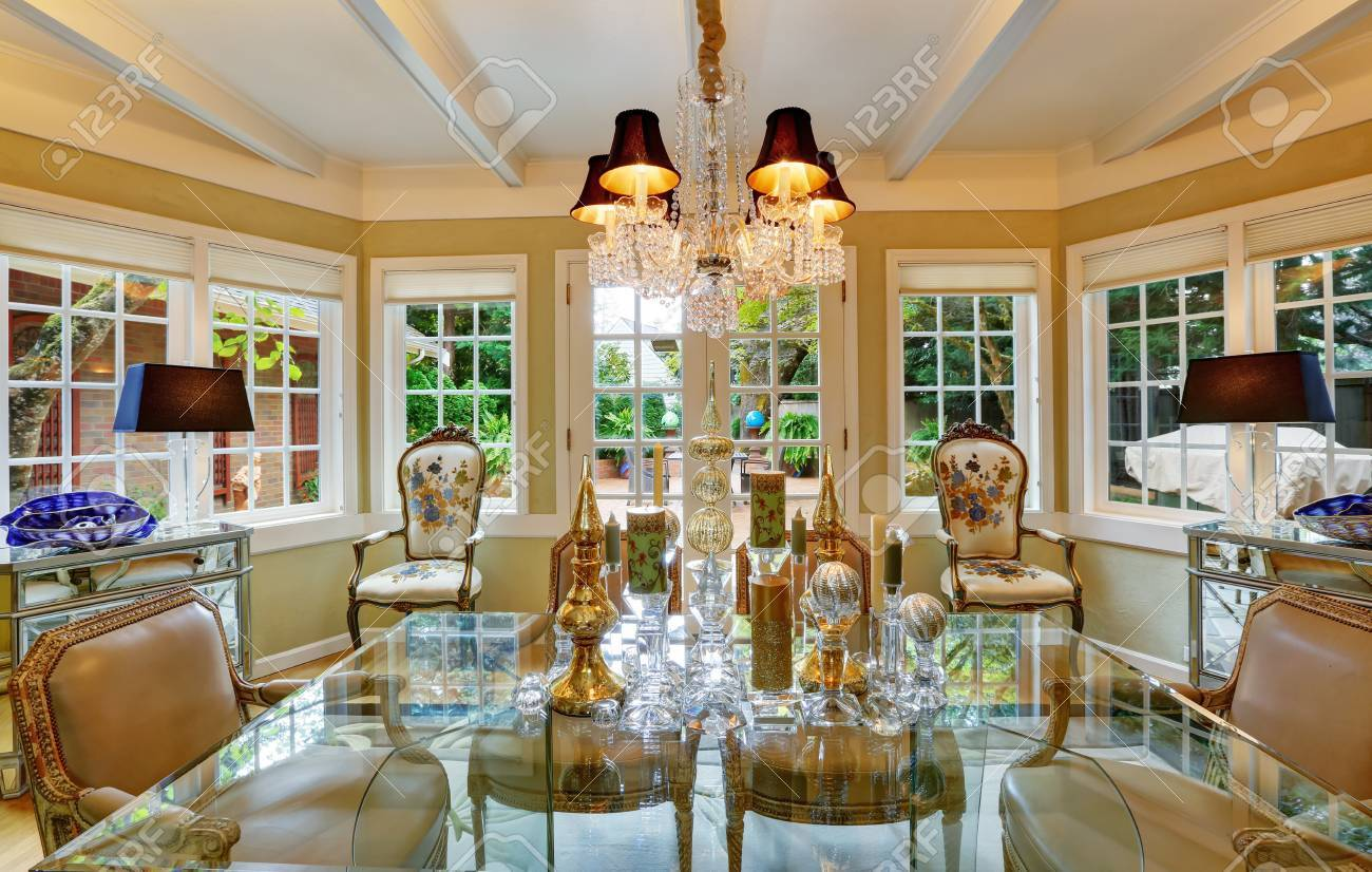 Lovely victorian style dining room interior with glass table..