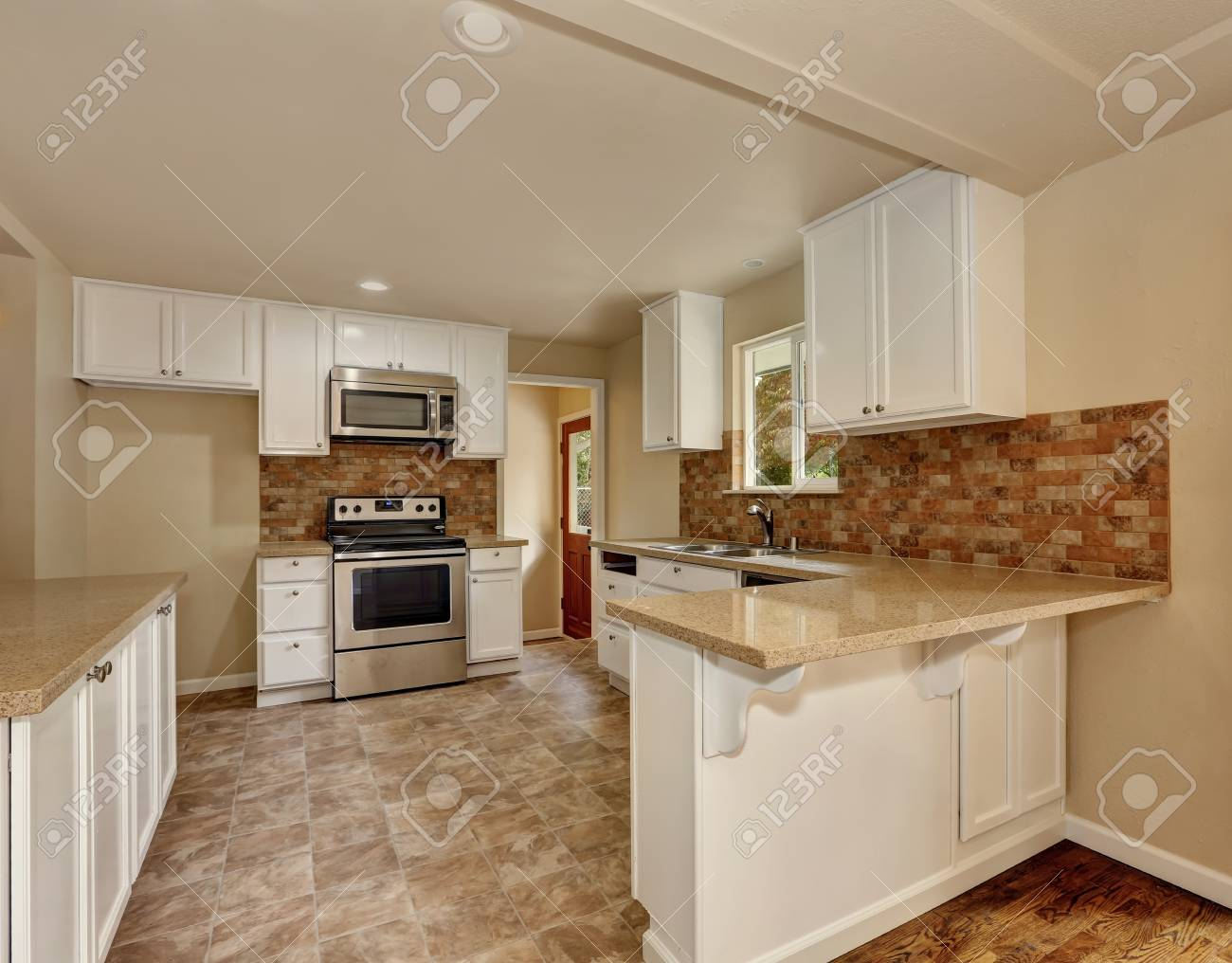 - American Classic Style Kitchen Room Interior With White Cabinets