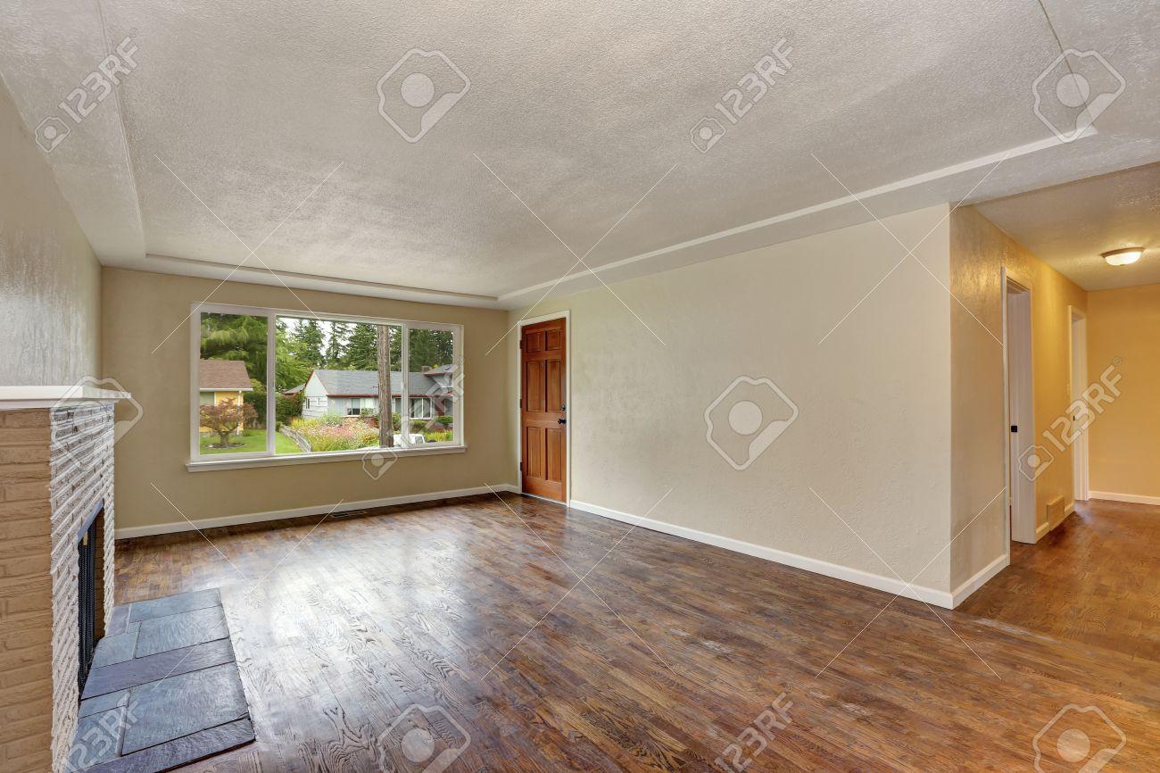 dark brown hardwood floors. Stock Photo - Unfurnished Beige Living Room Interior In Empty House With Fireplace And Dark Brown Hardwood Floor. Northwest, USA Floors