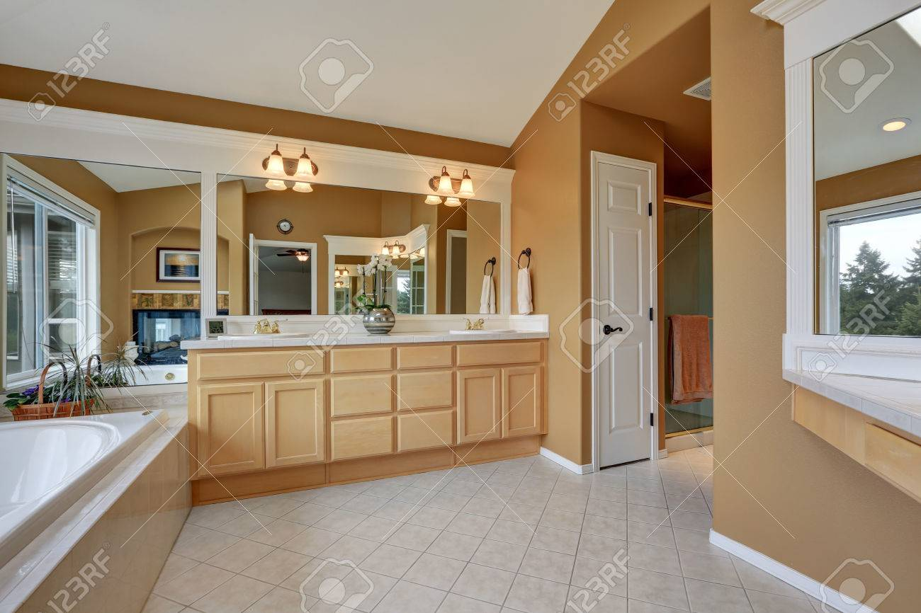 Luxury Bathroom Interior Orange Brown Walls And Vaulted Ceiling Stock Photo Picture And Royalty Free Image Image 67381646
