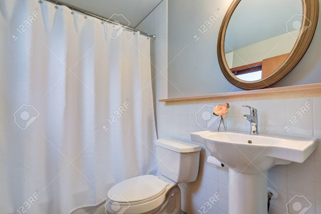 White Clean Bathroom With Washbasin Stand And Round Mirror ,.. Stock ...