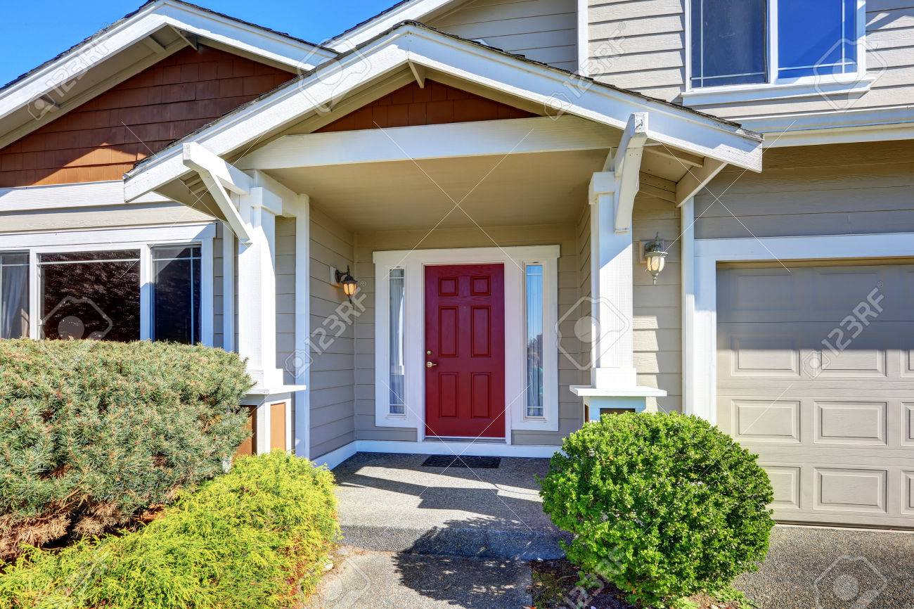 Lovely Entrance Porch With Red Front Door. House Exterior. Northwest, USA Stock  Photo