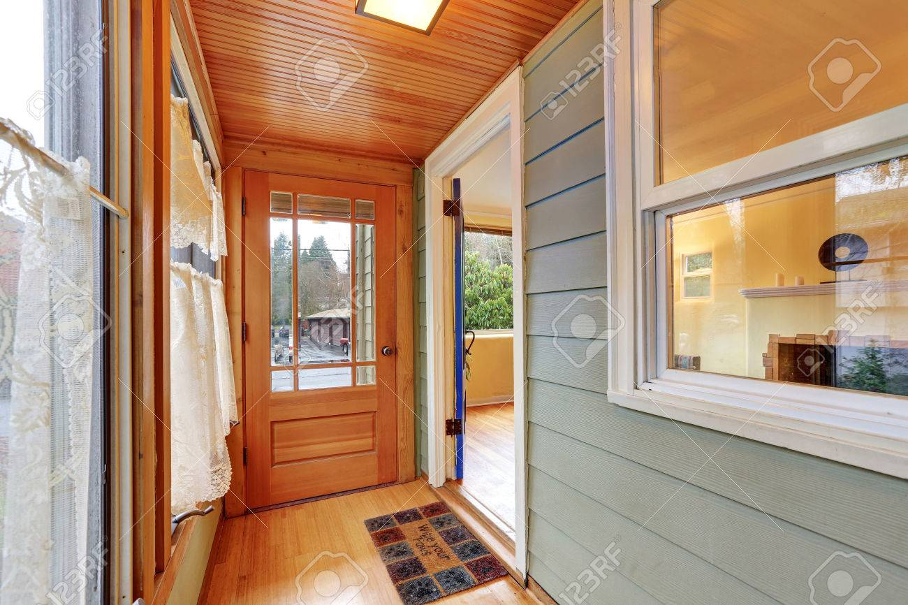 Entrance Porch Interior With Wood Paneling Window Curtains And