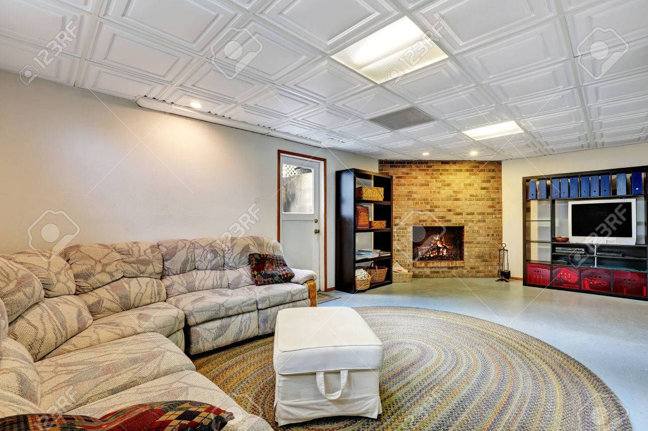 Light Living Room Remodel With Tiled Ceiling Large Sofa Brick