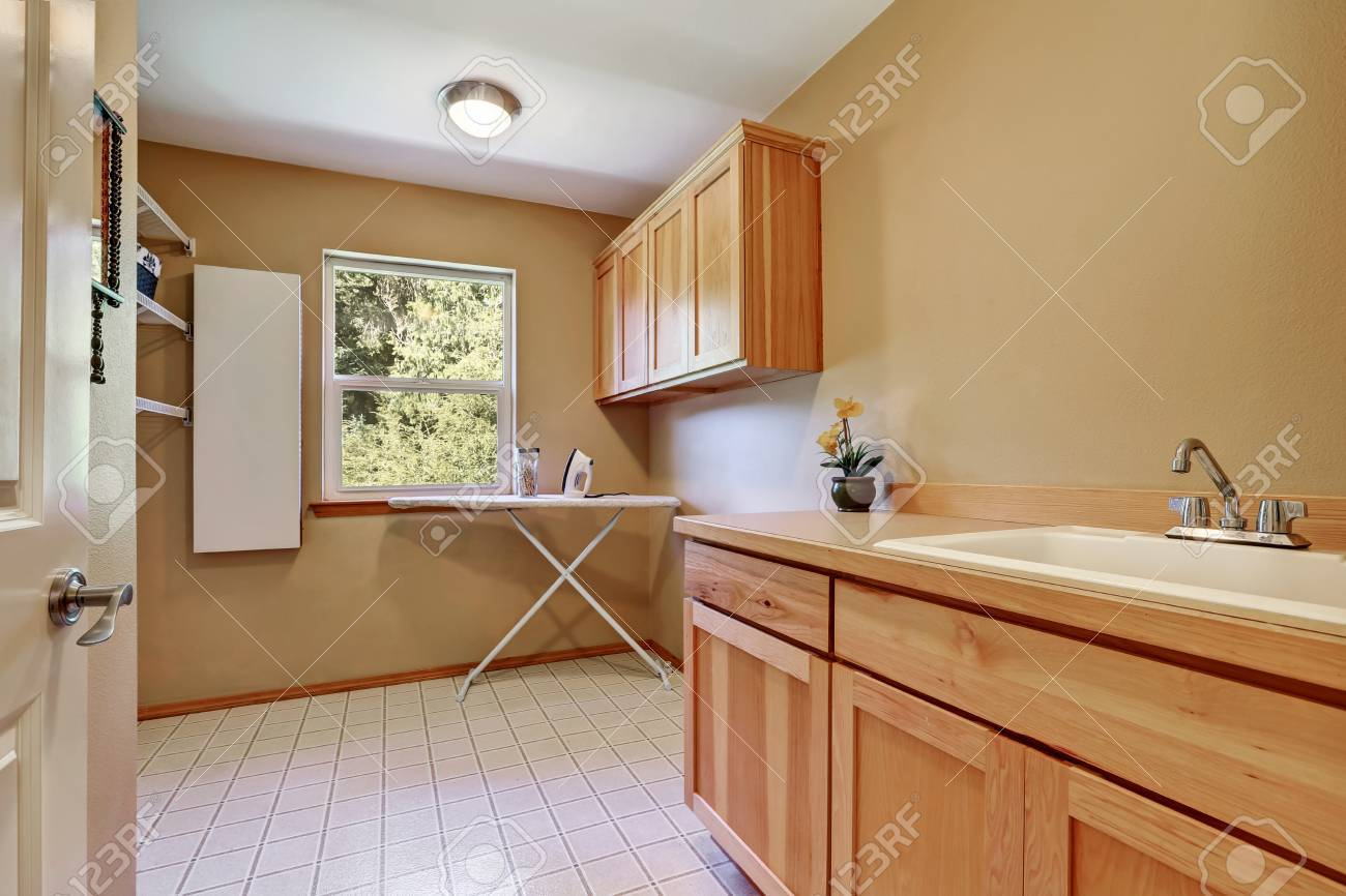 Laundry Room Interior With Vanity Cabinet, Tile Flooring And Light Brown  Walls. Northwest,