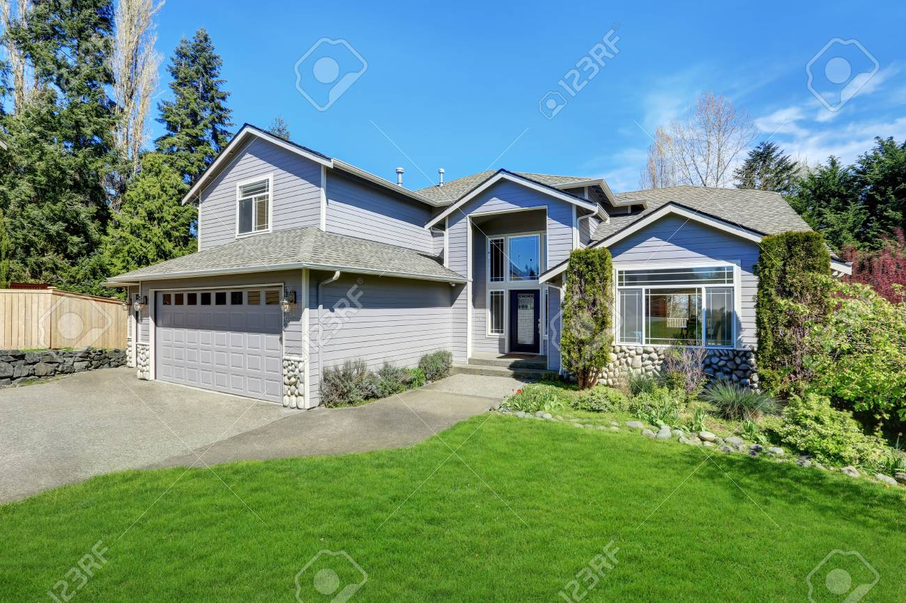 Stock Photo   Traditional Blue Home Exterior In Puyallup With Wood Siding  And Elegant Front Door. Northwest, USA