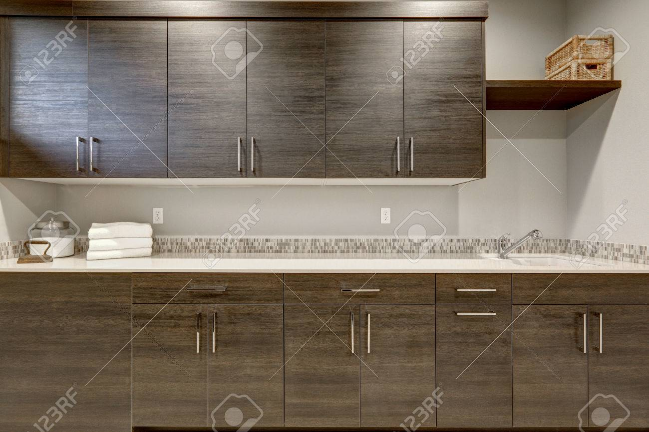 - Stunning Wet Bar With Dark Wood Shaker Cabinets And White