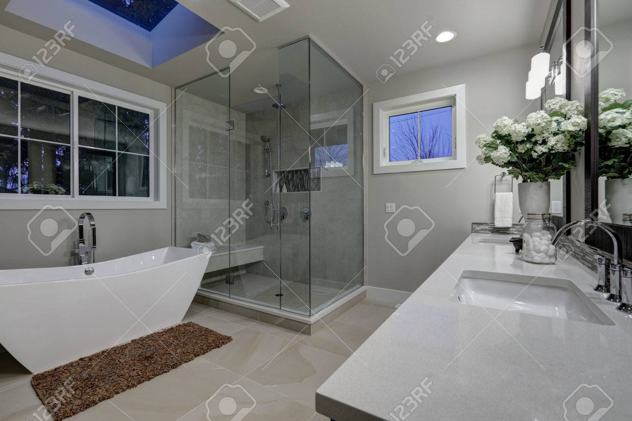 Amazing Gray Master Bathroom With Large Glass Walk In Shower, Freestanding  Tub And Skylights