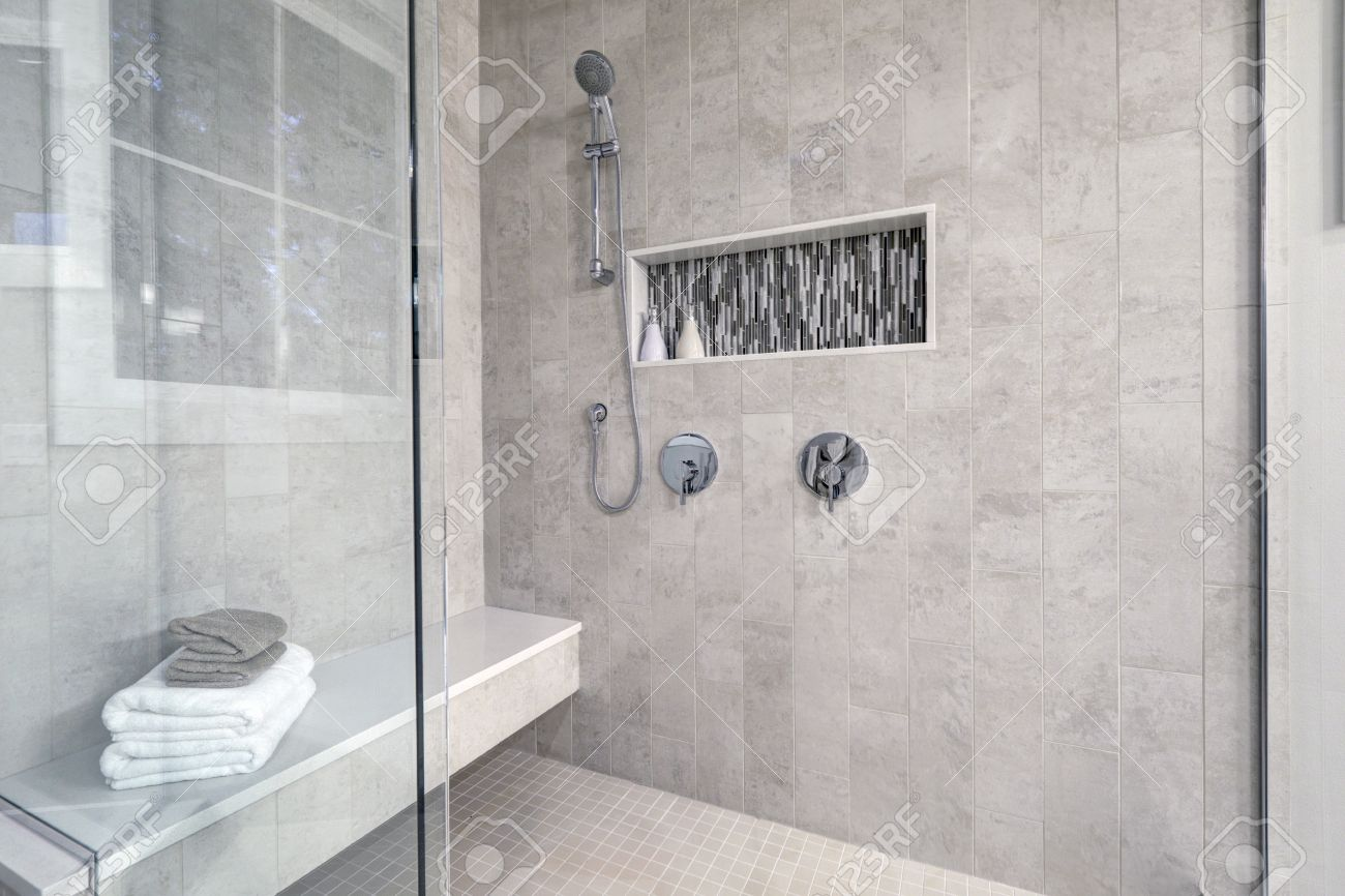 Glass Walk-in Shower With Gray Subway Tiled Surround Accented ...