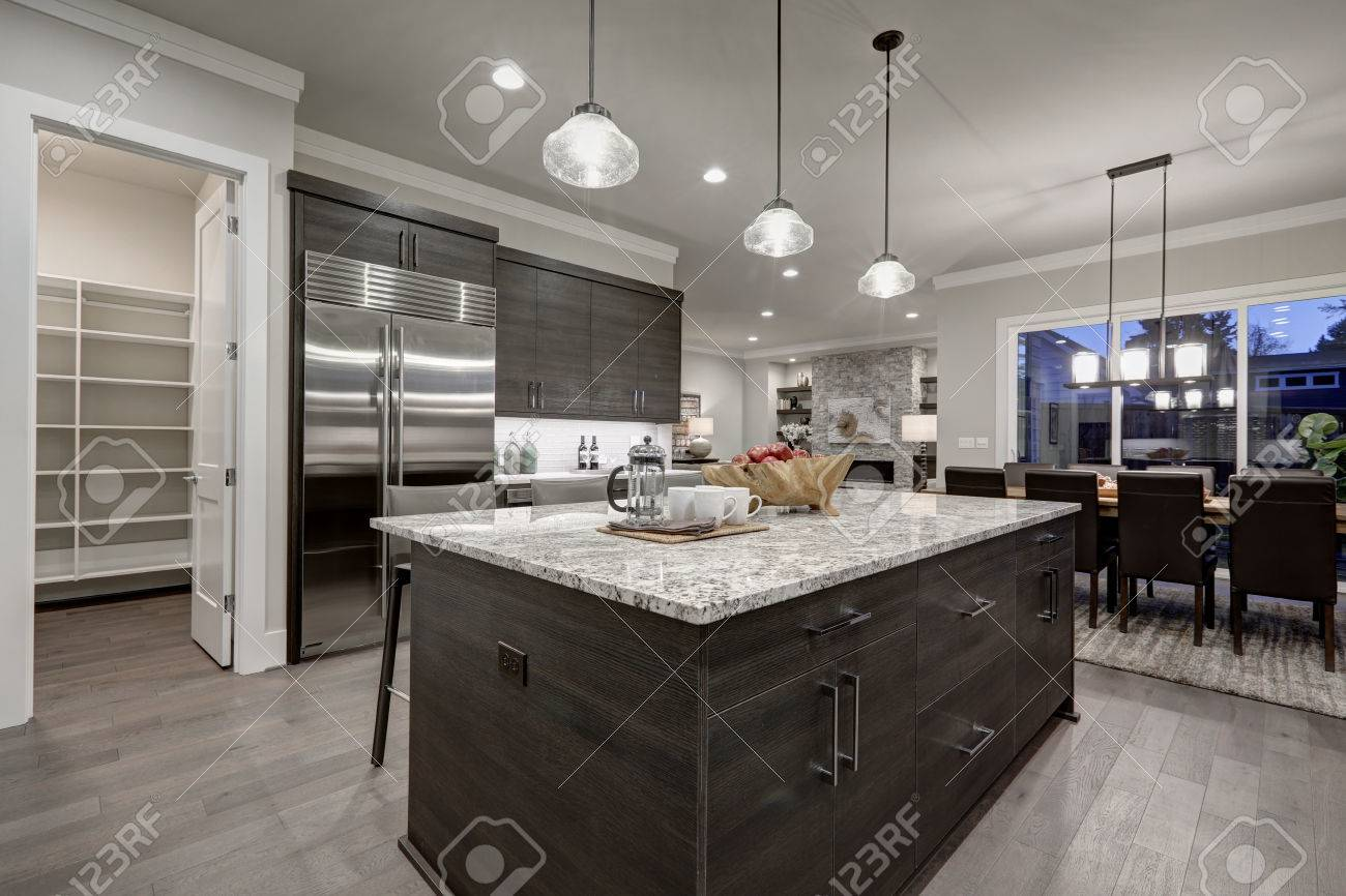 Modern Open Plan Gray Kitchen Features Dark Gray Cabinets Paired - Granite for gray cabinets