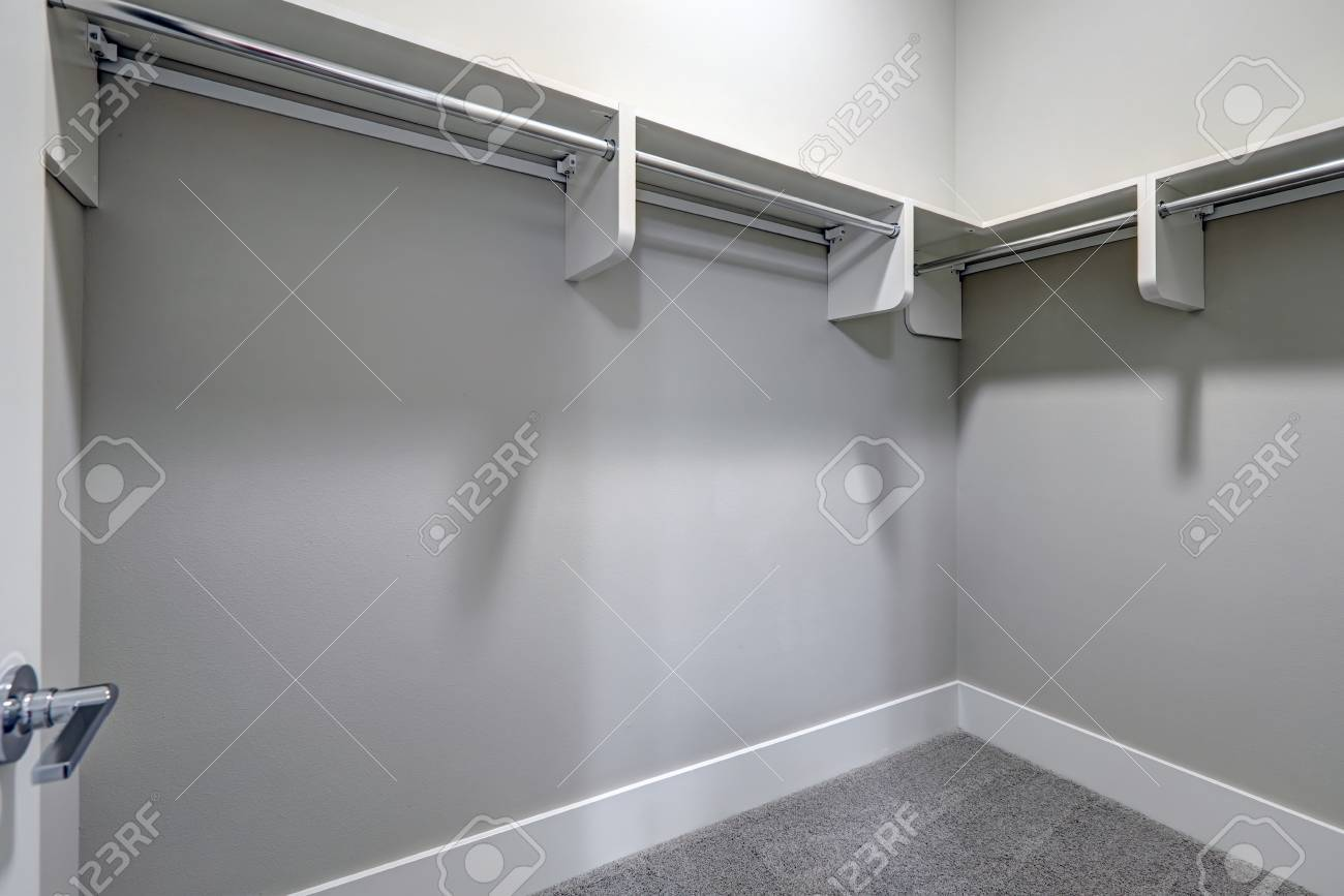 Beau Empty Walk In Closet With Pale Gray Walls Paint Color And Carpet Floor.  Northwest