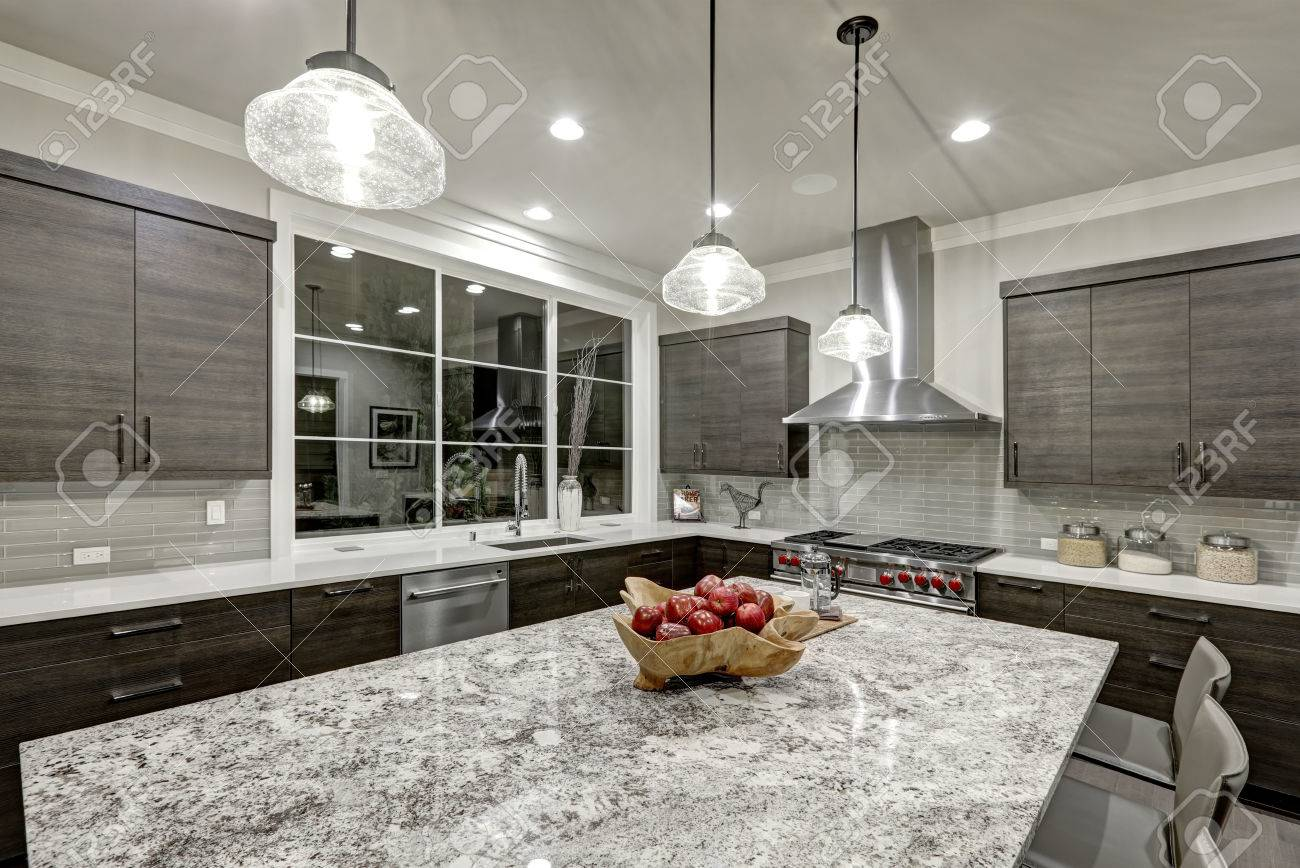 Modern Traditional Kitchen Design In New Luxury Home Features Dark Gray  Cabinets, White Quartz And