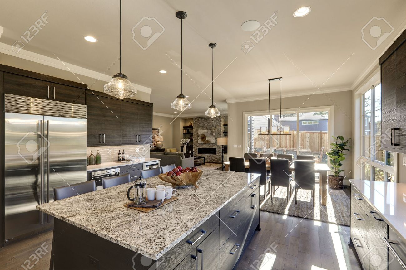 Modern Gray Kitchen Features Dark Gray Cabinetry Paired With.. Stock ...