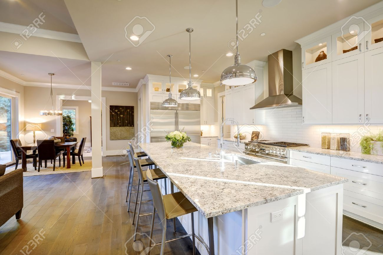 White Kitchen Design Features Large Bar Style Kitchen Island.. Stock ...