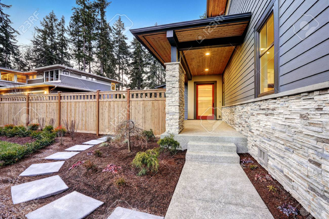 Entrance Of Luxurious New Construction Home With Blue Siding.. Stock ...