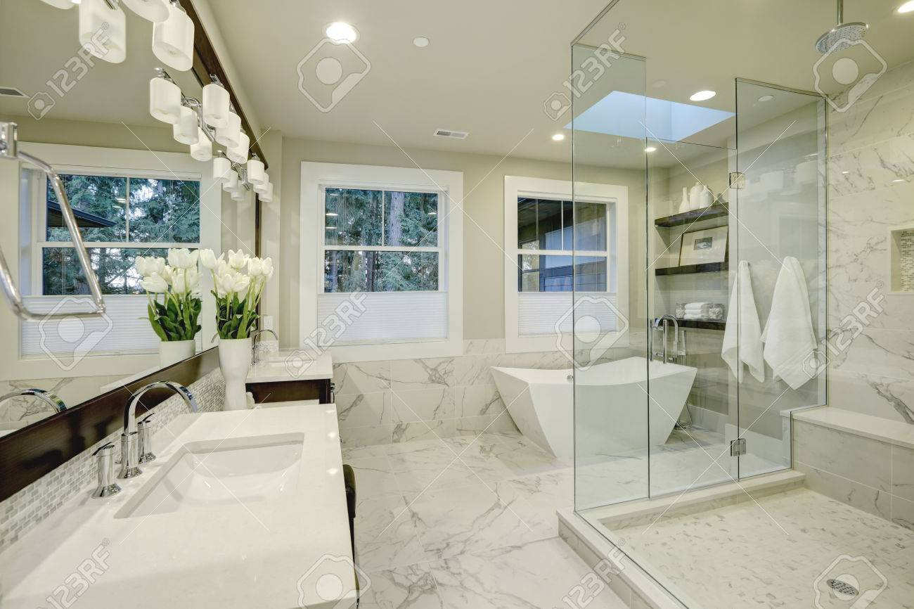 Amazing White And Gray Marble Master Bathroom With Large Glass - Master bathroom with freestanding tub