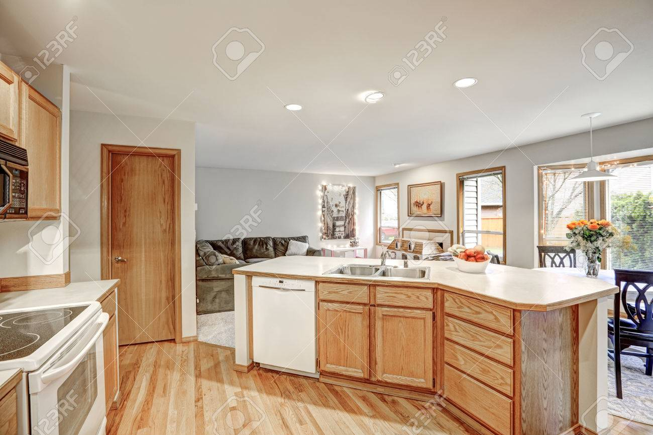 Traditional kitchen room design in neutrals colors accented with..