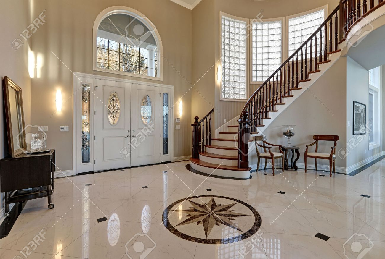 Stock Photo - Stunning two story entry foyer with lots of space boasts marble mosaic tile floor front door framed with arch window and sidelights ... : foyer door - pezcame.com