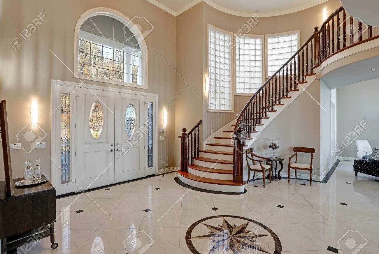 Stunning two story entry foyer with lots of space boasts marble stunning two story entry foyer with lots of space boasts marble mosaic tile floor front dailygadgetfo Gallery