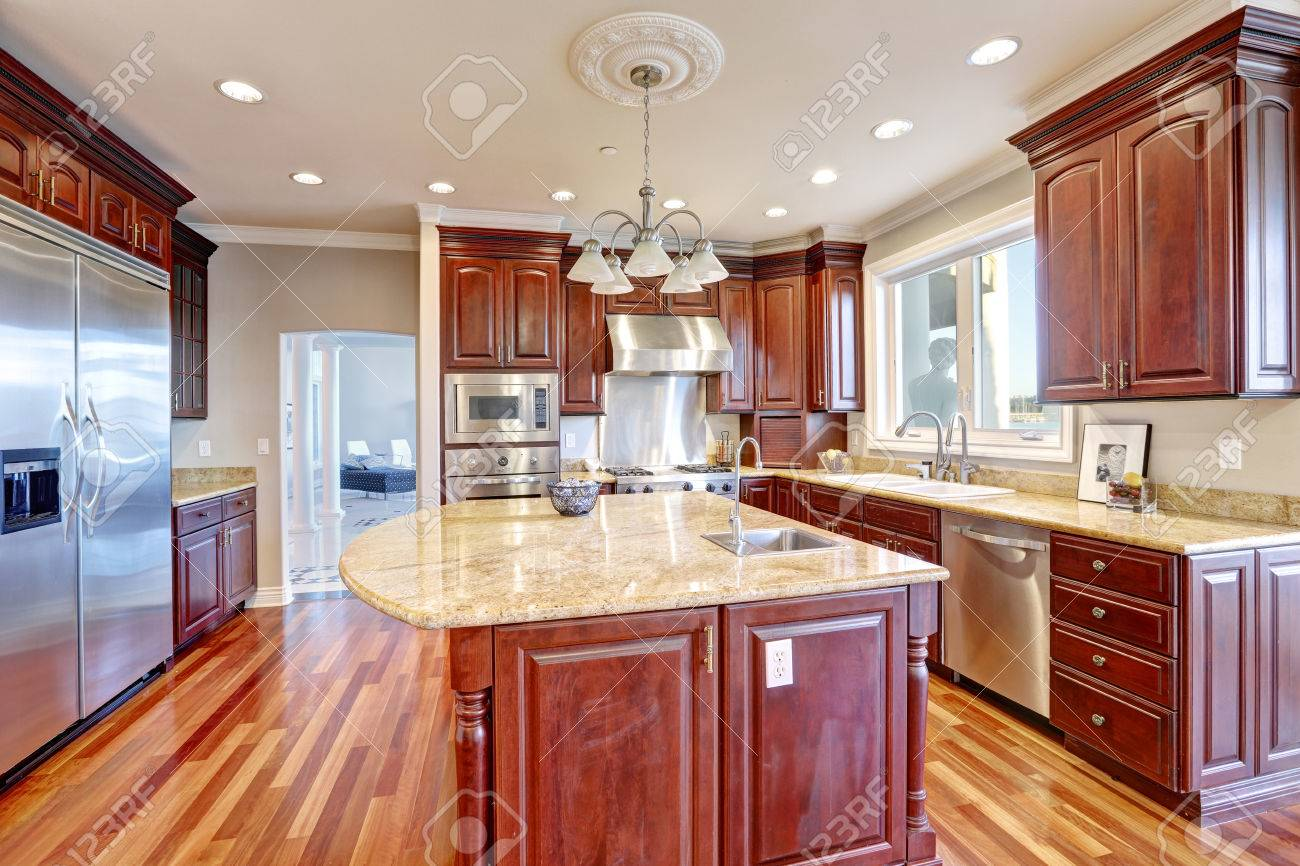 Warm and inviting kitchen with large kitchen island, cherrywood..