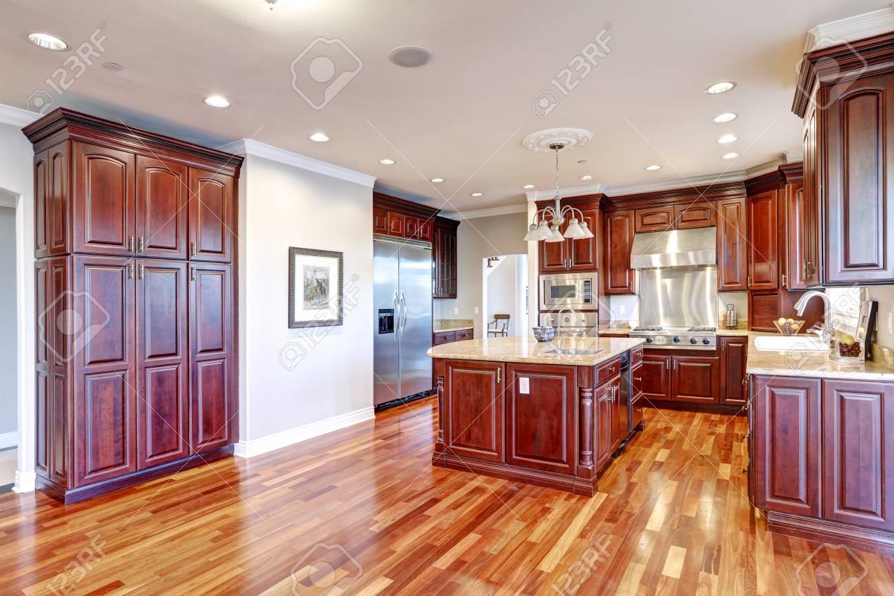 Warm and inviting kitchen boasts large kitchen island, cherrywood..