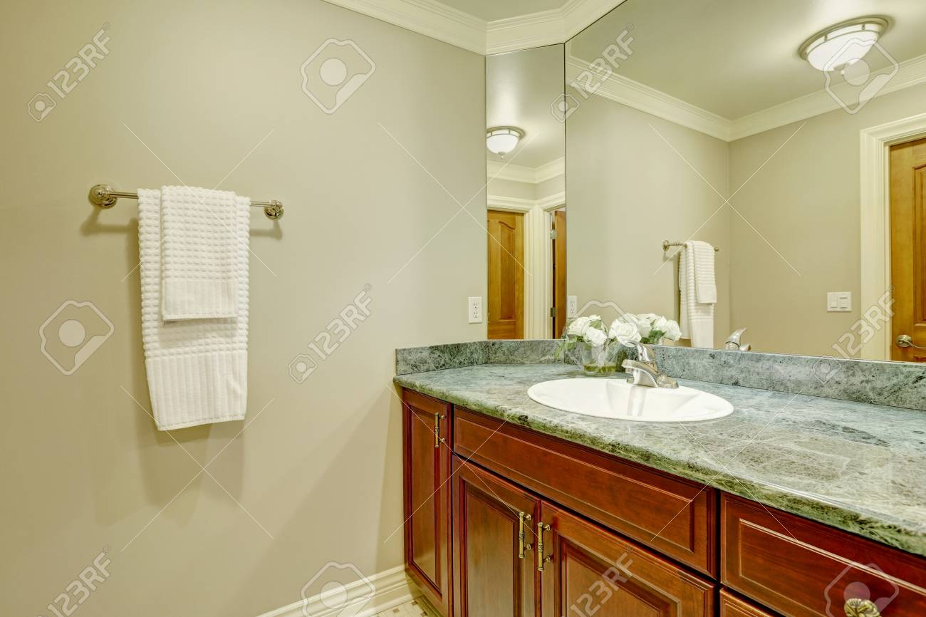 Bathroom Design With Soft Creamy Walls And Vanity Cabinet Accented ...