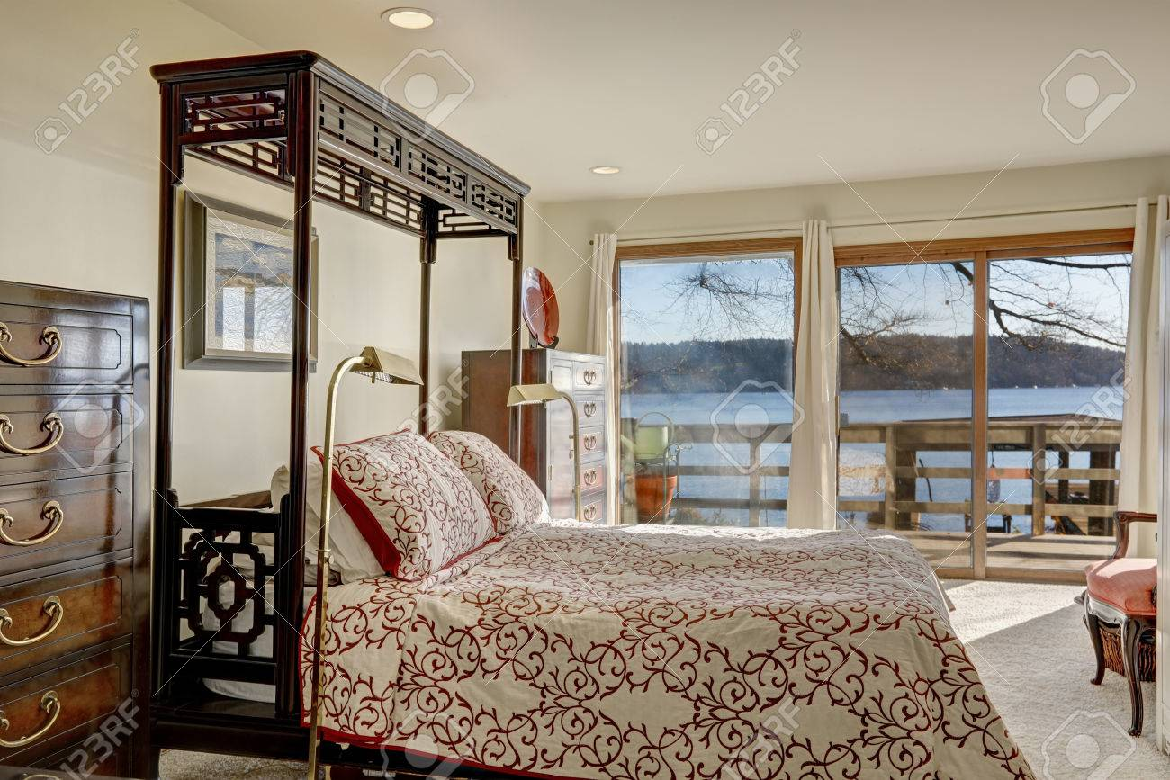 - Waterfront Home Bedroom Interior Boasts King Size Half Canopy