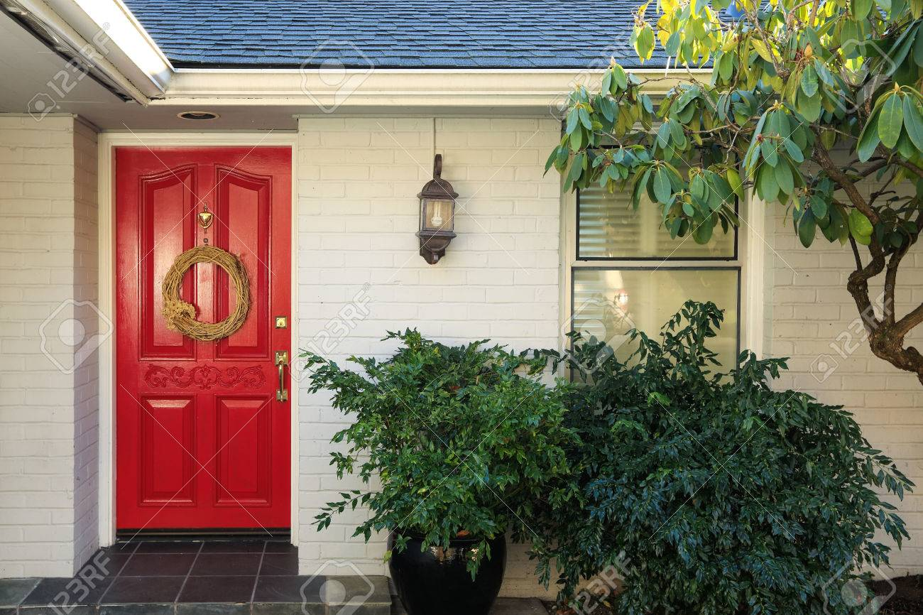 Front Porch With White Painted Brick Exterior Red Entrance Door
