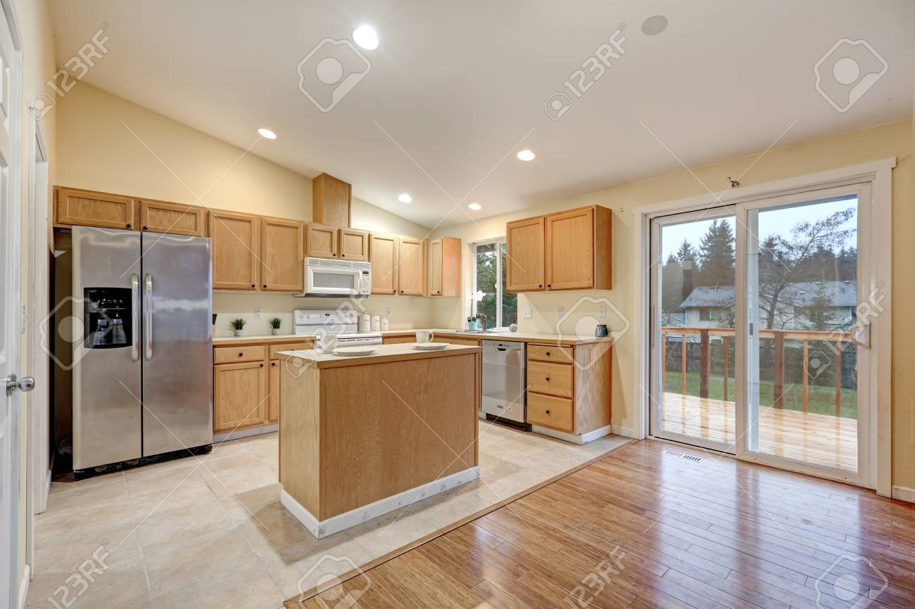 Light Open Concept Kitchen Room With Vaulted Ceiling Tile Floor