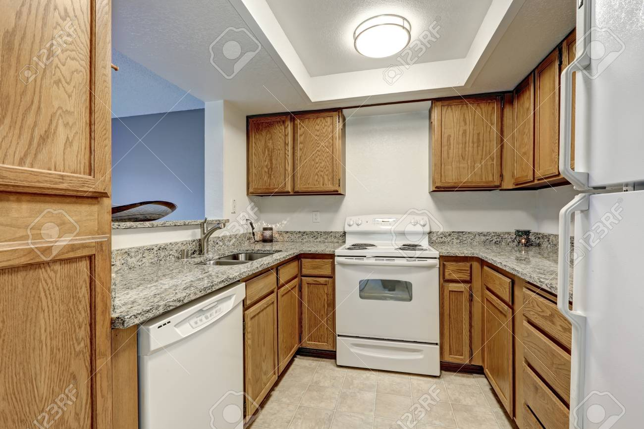 Small U Shaped Kitchen Filled With Wood Cabinets Paired With.. Stock on gray and white small kitchen, gray bathrooms, gray and white kitchen curtains, gray butcher block, gray composite kitchen sinks, gray cabinets wood floors, gray stained cabinets, gray and white french kitchen, white w gray island cabinets, gray and wood cabinets, kitchens with gray cabinets, grey floor white cabinets, cream walls white cabinets, gray black and white kitchens, dark lower cabinets white upper cabinets, gray mirrored cabinet, gray cabinets with white granite, gray and rustic kitchen, orange color cabinets, backsplash for gray cabinets,